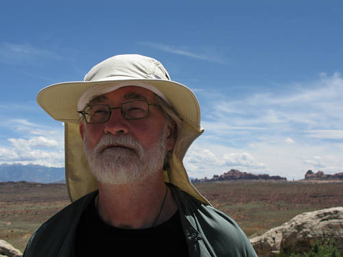 Mark with his hat against a horizon in Canyonland
