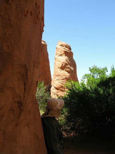 Mark viewing rock formation near Sand Dune Arch