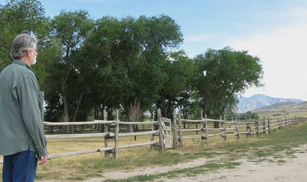Mark Standing By Fence of Fielding Garr Farm