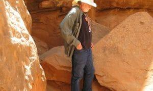 Mark among red rocks phone on ground